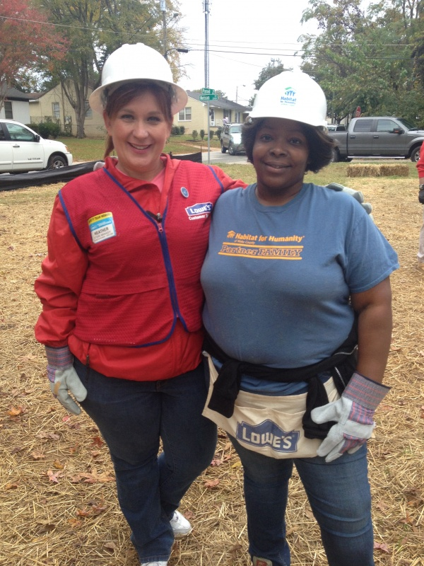 Lowe's employee with Habitat homeowner Latisha