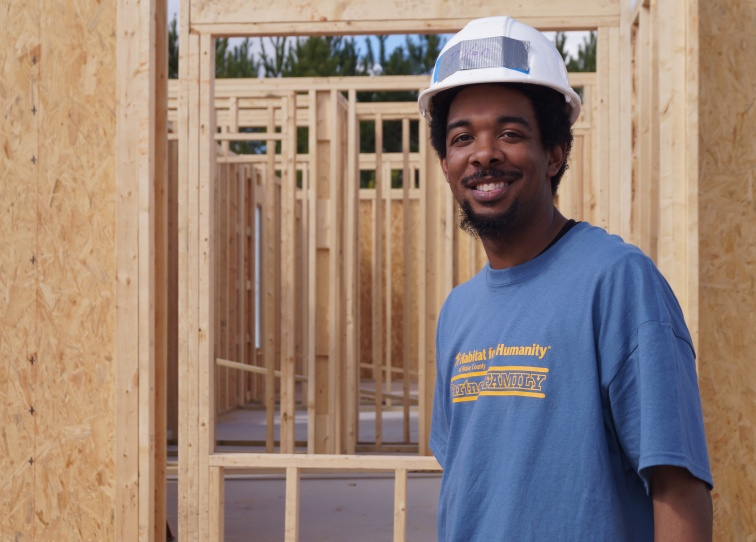 Habitat Wake homeowner D'von on the construction site building his new home.